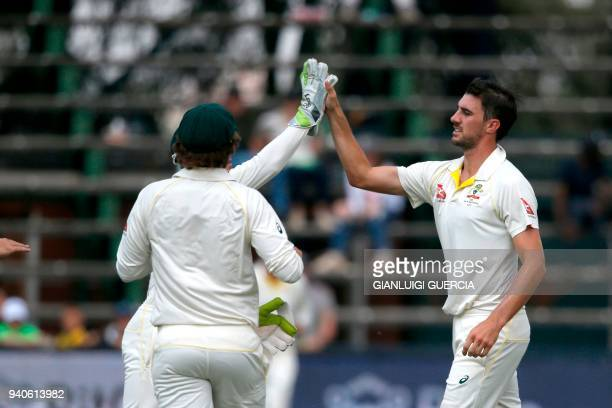 Australian bowler Pat Cummins celebrates the dismissal of South African batsman Aiden Markram on the third day of the fourth Test cricket match...