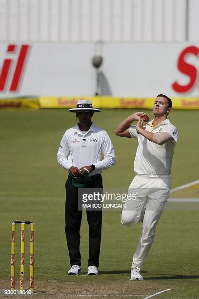 Australian bowler Pat Cummins delivers a ball during the second days play of the second cricket Test match between South Africa and Australia at St...