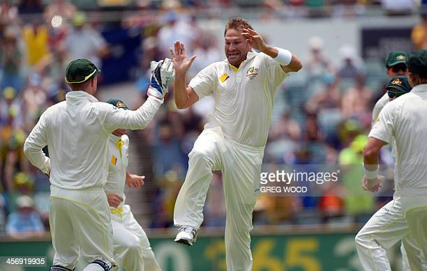 Australian bowler Ryan Harris celebrates after dismissing England batsman Alastair Cook for no runs on the fourth day of the third Ashes cricket Test...
