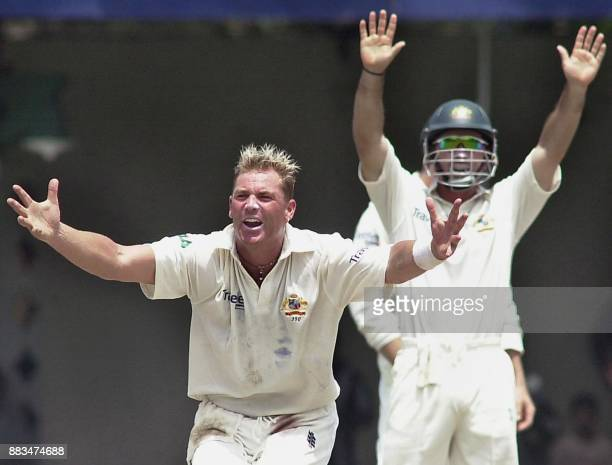 Australian bowler Shane Warne and teammate Damian Martin succesfully appeal for leg before wicket decision against Pakistani batsman Younis Khan...