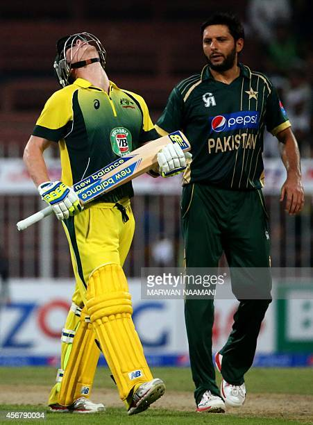 Australian bowler Steven Smith reacts after reaching a century as he passes Pakistani bowler Shahid Afridi during their first One Day International...