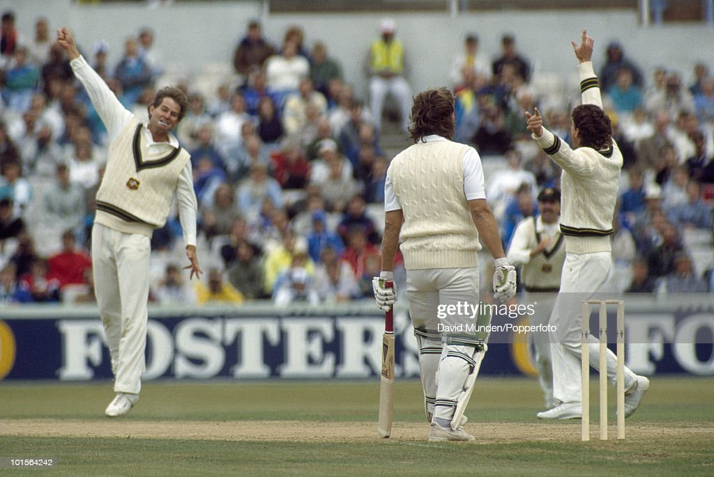 Australian bowler Terry Alderman (left) celebrates after taking the wicket of Ian Botham LBW for 4 with England on 38 for 5 in their second innings on the fourth day of the 4th Test match between England and Australia at Old Trafford in Manchester, 31st July 1989. Australia won by 9 wickets.