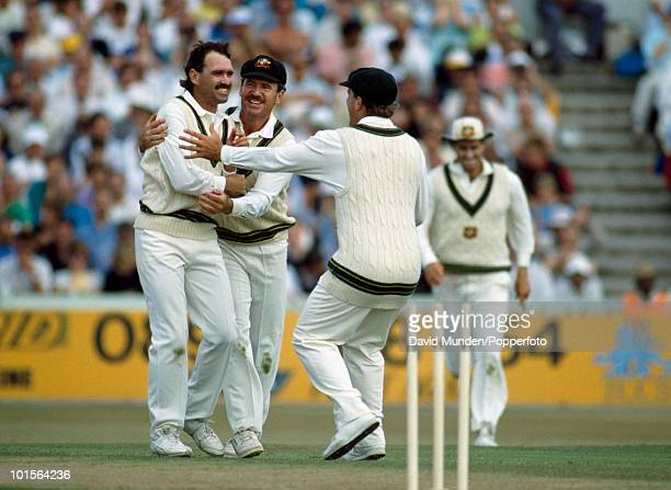 Australian bowler Trevor Hohns is congratulated by Allan Border and Mark Taylor after bowling England batsman Ian Botham for 0 on the first day of...