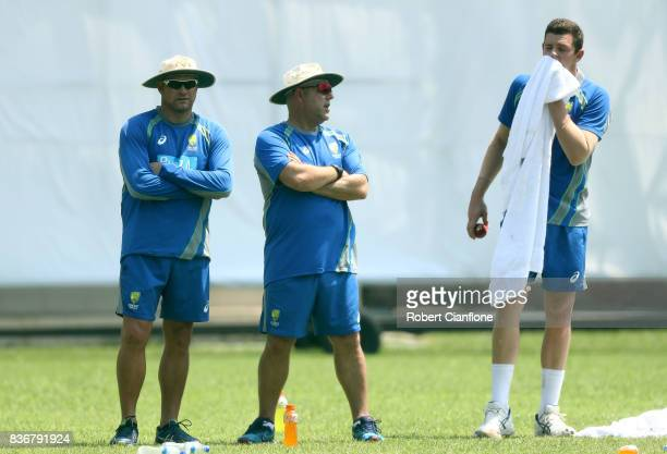 Australian bowling coach Ryan Harris and Australian coach Darren Lehman talk with Josh Hazlewood during an Australian Test team nets session at SherE...