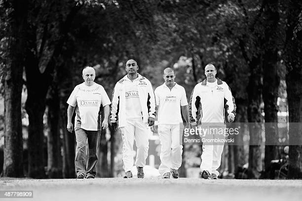 Australian Boxer Alex Leapai walks down an alley with staff ahead of his fight against Vladimir Klitschko on April 24 2014 in Dusseldorf Germany
