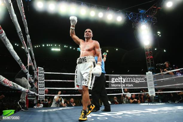 Australian boxer Anthony Mundine claims victory after his cruiserweight bout with Danny Green at Adelaide Oval on February 3 2017 in Adelaide...
