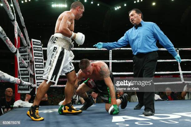 Australian boxer Anthony Mundine looks on as Danny Green gets up during their cruiserweight bout at Adelaide Oval on February 3 2017 in Adelaide...