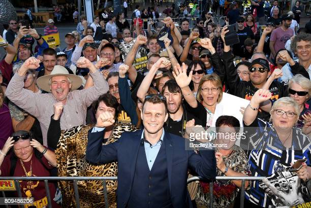 Australian boxer Jeff Horn celebrates with fans during a ticker tape parade on July 6 2017 in Brisbane Australia Horn beat Manny Pacquiao on Sunday...
