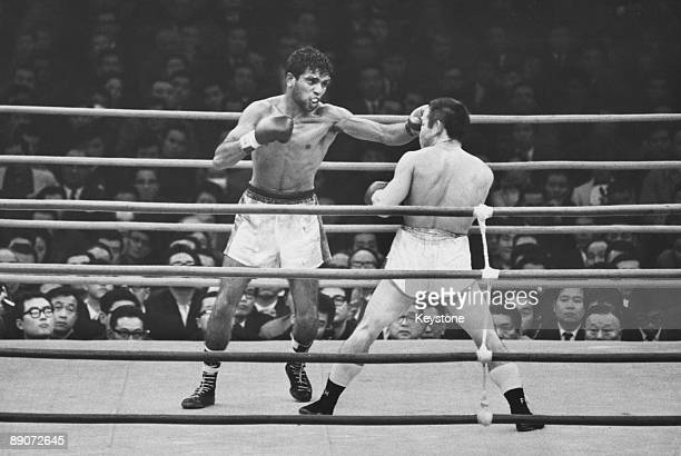 Australian boxer Lionel Rose gets a left hand punch to the head of defending world bantamweight champion Masahiko 'Fighting' Harada during their...