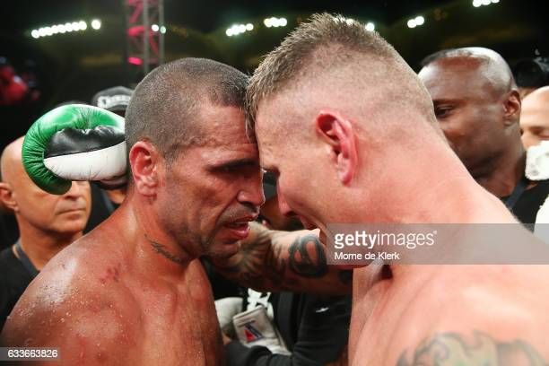 Australian boxers Anthony Mundine and Danny Green hug after their cruiserweight bout at Adelaide Oval on February 3 2017 in Adelaide Australia