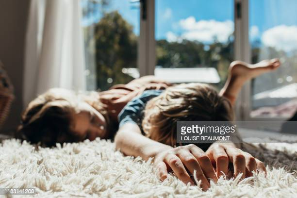 australian brother and sister relax in the sun - next to stock pictures, royalty-free photos & images