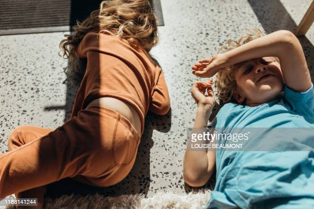 australian brother and sister relax in the sun - nightwear stock pictures, royalty-free photos & images