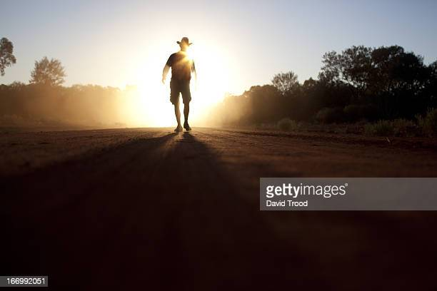 Australian bush man walking in the dust