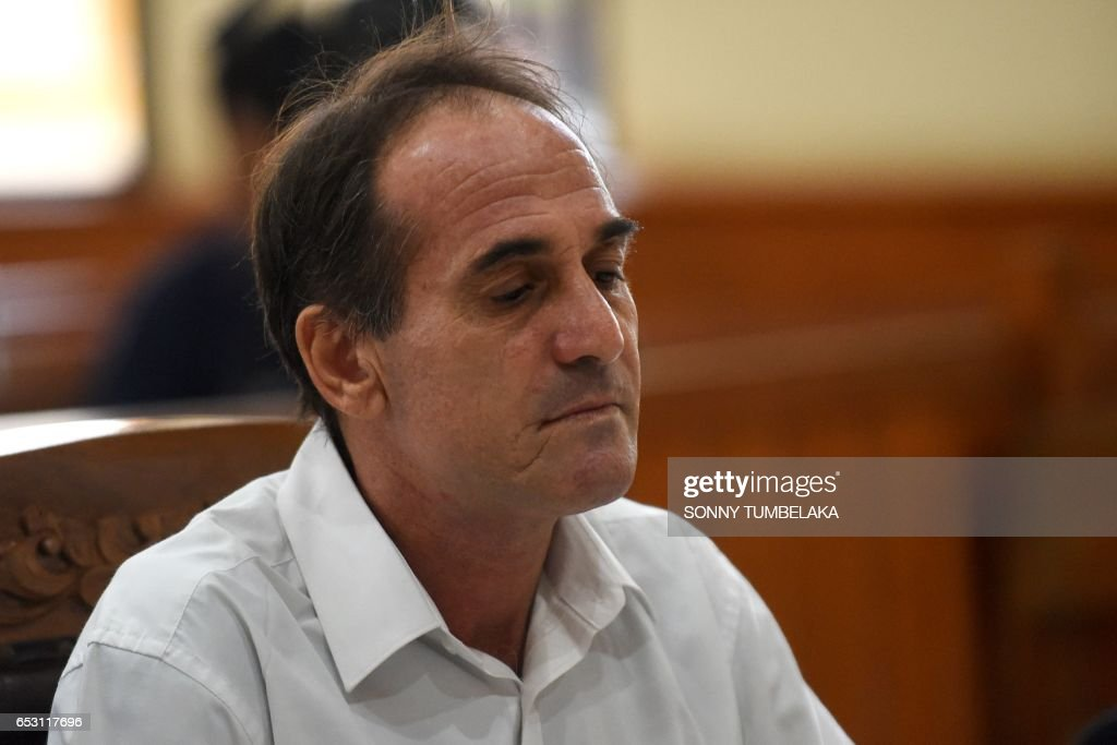 Australian businessman Giuseppe Serafino attends his trial at a court in Denpasar on Indonesia's resort island of Bali on March 14, 2017. Serafino is charged with using, possessing and transporting hashish after allegedly being caught in possession of small amounts of the drug in October 2016. / AFP PHOTO / Sonny TUMBELAKA