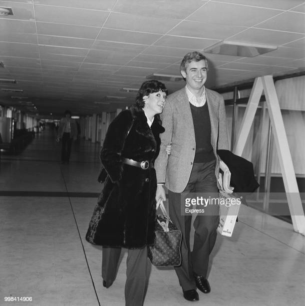 Australian businessman Nicholas Whitlam son of Prime Minister Gough Whitlam of Australia pictured with his wife Judy Frye at Heathrow airport in...