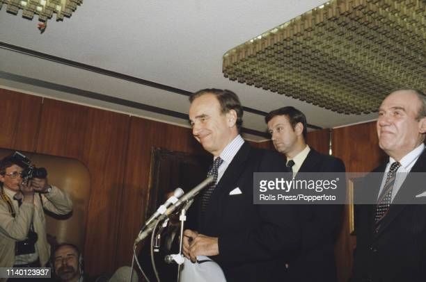 Australian businessman Rupert Murdoch, owner of News International, pictured attending a press conference with John Collier , joint managing director...