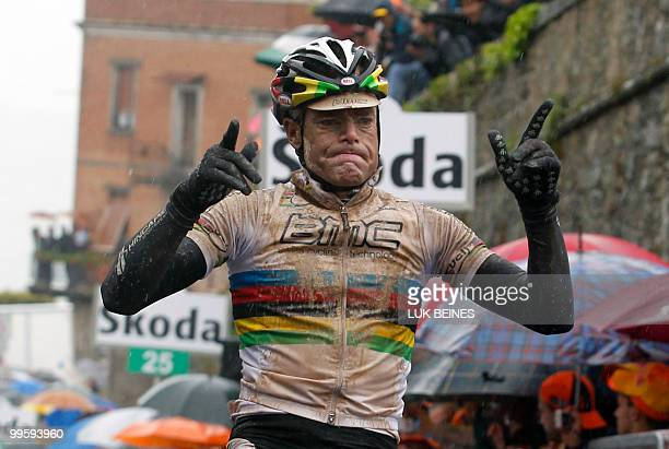 Australian Cadel Evans crosses the finish line of the seventh stage of the 93rd Giro d'Italia going from Carrara to Montalcino in victory on May 15...