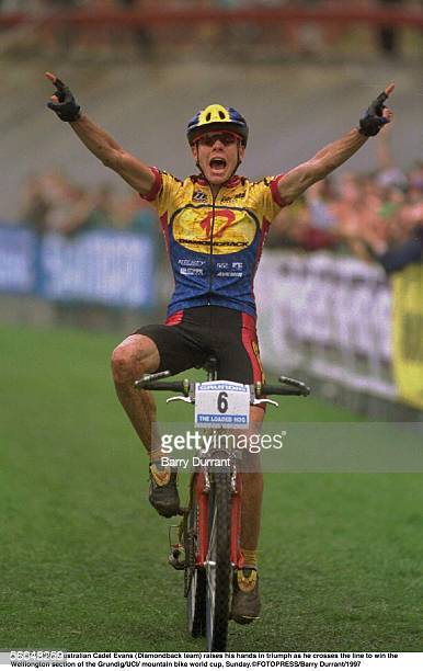 Australian Cadel Evans raises his hands in triumph as he crosses the line to win the welliongton section of the Grundig/UCI/mountain bike world cup,...