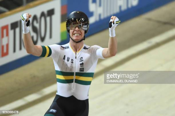 Australian Cameron Meyer celebrates winning the men's points race final during the UCI Track Cycling World Championships in Apeldoorn on March 2 2018...