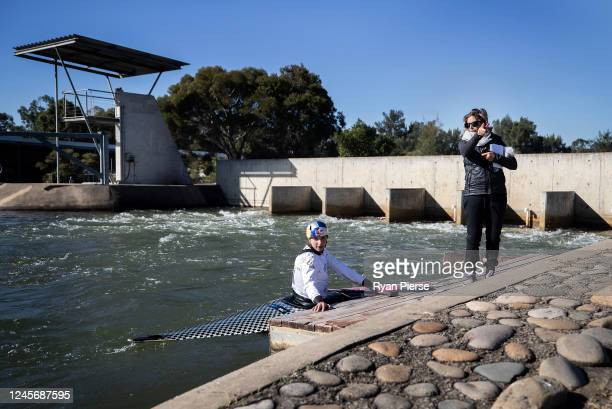 Australian Canoeist Jess Fox speaks to her mother and coach Miriam Fox-Jerusalmi while training at Penrith Whitewater Stadium on June 05, 2020 in...