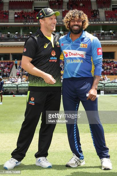 Australian captain Aaron Finch and Sri Lankan captain Lasith Malinga take part in the coin toss before during the Twenty20 International match...