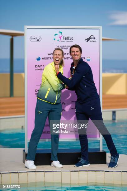 Australian captain Alicia Molik and Netherlands captain Paul Haarhuis pose for a photo during the official draw ahead of the World Group PlayOff Fed...