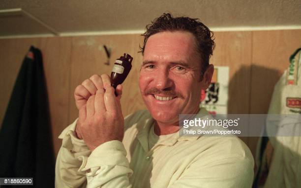 Australian captain Allan Border holds the Ashes urn after Australia won the 4th Test match between England and Australia by an innings and 148 runs...