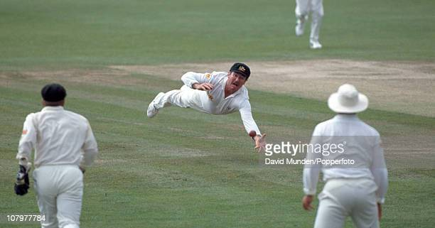 Australian captain Allan Border just fails to take a spectacular catch during the 1st Test match between England and Australia at Old Trafford in...