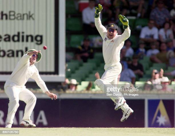 Australian Captain and wicketkeeper Mark Taylor leaps up in celebration after catching out Michael Atherton off a ball from Damien Fleming this...