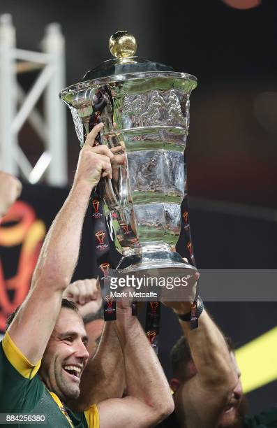 Australian captain Cameron Smith lifts the winners trophy after victory during the 2017 Rugby League World Cup Final between the Australian Kangaroos...
