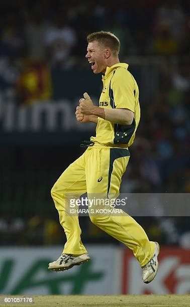 Australian captain David Warne celebrates after he dismissed Sri Lanka cricketer Chamara Kapugedera during the final T20 international cricket match...