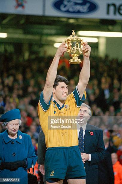 Australian captain John Eales holds aloft the William Webb Ellis trophy after Australia's 35-12 win over France in the Rugby Union World Cup.