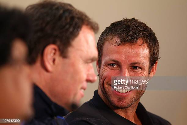 Australian captain Lucas Neill talks with coach Holger Osieck during the Australian Socceroos official prematch media conference at the Main Media...