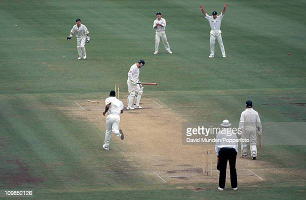 Australian captain Mark Taylor is bowled by Devon Malcolm for 113 during the 3rd Test match between Australia and England at the Sydney Cricket...