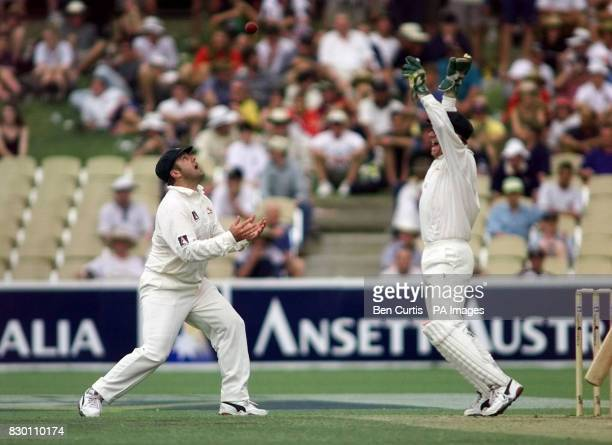 Australian Captain Mark Taylor throws the ball in the air and wicketkeeper Ian Healy celebrates after Taylor caught out Michael Atherton this...