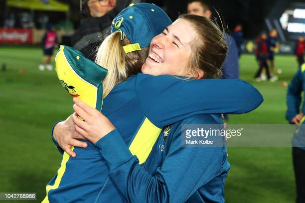 Australian captain Meg Lanning embraces Georgia Wareham of Australia after presenting her with her cap before her debut during game one of the...