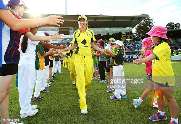 Australian captain Meg Lanning leads the team onto the field during game one of the Women's ODI series between Australia and India at Manuka Oval on...