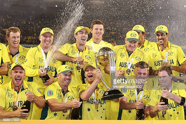 Australian captain Michael Clarke and Australian players celebrate winning during the 2015 ICC Cricket World Cup final match between Australia and...