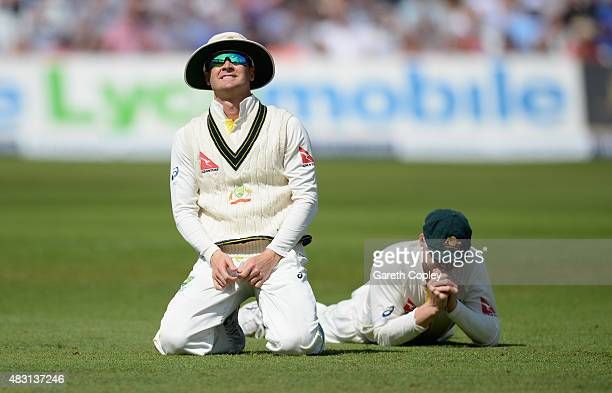 Australian captain Michael Clarke and Steven Smith reacts after dropping England captain Alastair Cook during day one of the 4th Investec Ashes Test...