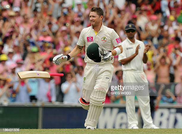 Australian captain Michael Clarke drops his bat as he prepares to raise his fist in the air as he celebrates after scoring his 300 on day three of...