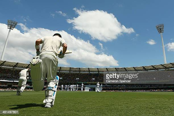 Australian captain Michael Clarke runs onto the field during day three of the First Ashes Test match between Australia and England at The Gabba on...