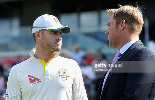 Australian captain Michael Clarke speaks with former cricketer Shane Warne at the close of play on day three of the 3rd Investec Ashes Test match...