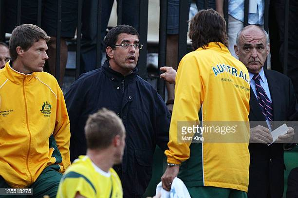 Australian captain Pat Rafter argues with ITF tournament referee Javier Moreno before play was stopped due to poor light during the Davis Cup World...