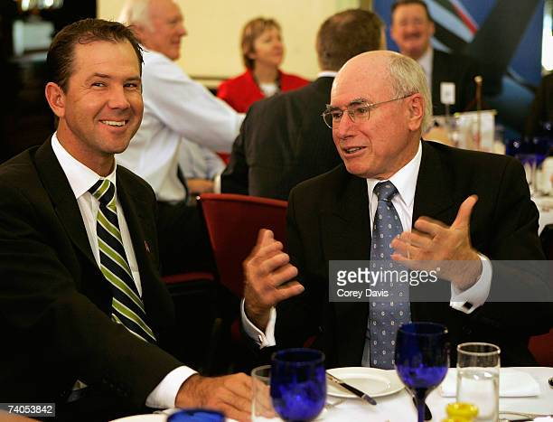 Australian captain Ricky Ponting and Australian Prime Minister John Howard share a story at the Australian World Cup team breakfast at the Sydney...