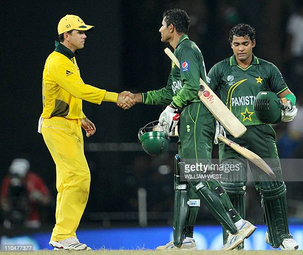 Australian captain Ricky Ponting congratulates Pakistan batsmen Abdul Razzaq and Umar Akmal after they steered Pakistan to victory over Australia in...