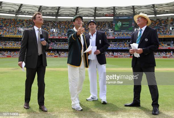 Australian captain Ricky Ponting tosses the coin with England captain Andrew Strauss looking on ahead of day one of the First Ashes Test match...