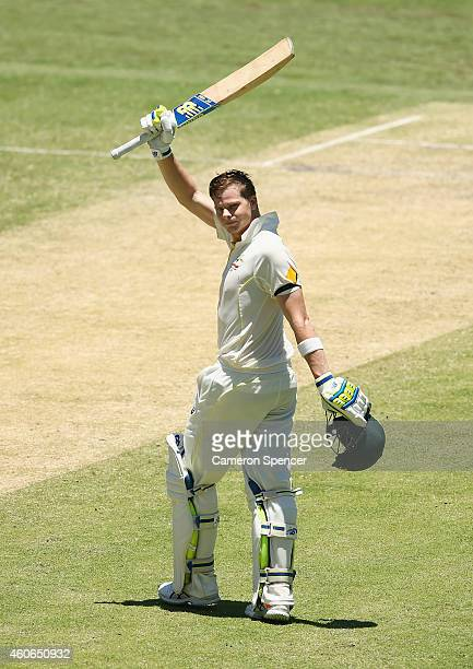 Australian captain Steve Smith celebrates scoring a century during day three of the 2nd Test match between Australia and India at The Gabba on...