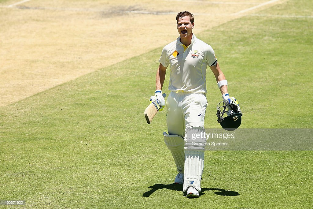 Australian captain Steve Smith celebrates scoring a century during day three of the 2nd Test match between Australia and India at The Gabba on December 19, 2014 in Brisbane, Australia.