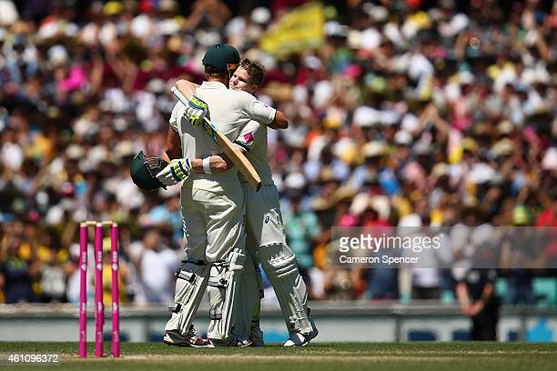 Australian captain Steve Smith celebrates with team mate Shane Watson after scoring a century during day two of the Fourth Test match between...