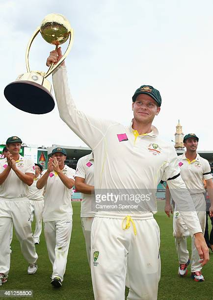 Australian captain Steve Smith holds the Border-Gavskar trophy aloft after winning the series during day five of the Fourth Test match between...